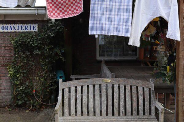klein - waslijn winkeldeur
